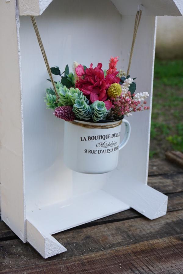 La boutique en caja de frutas flores en el columpio - Caja fruta decoracion ...